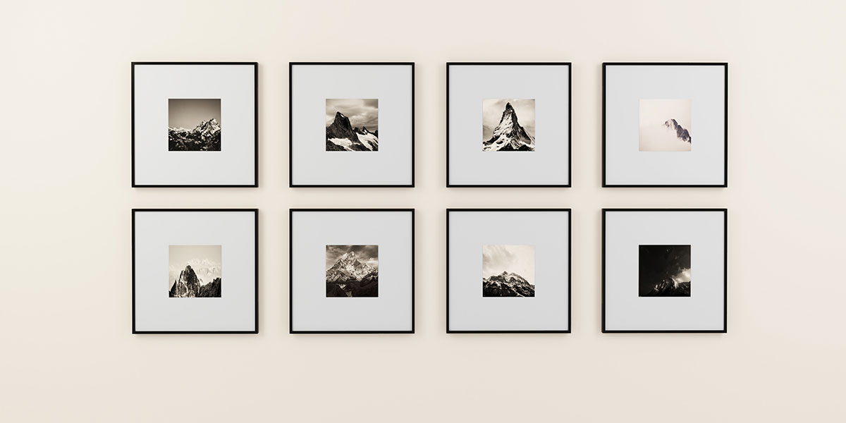 Eight square frames hanging on a wall