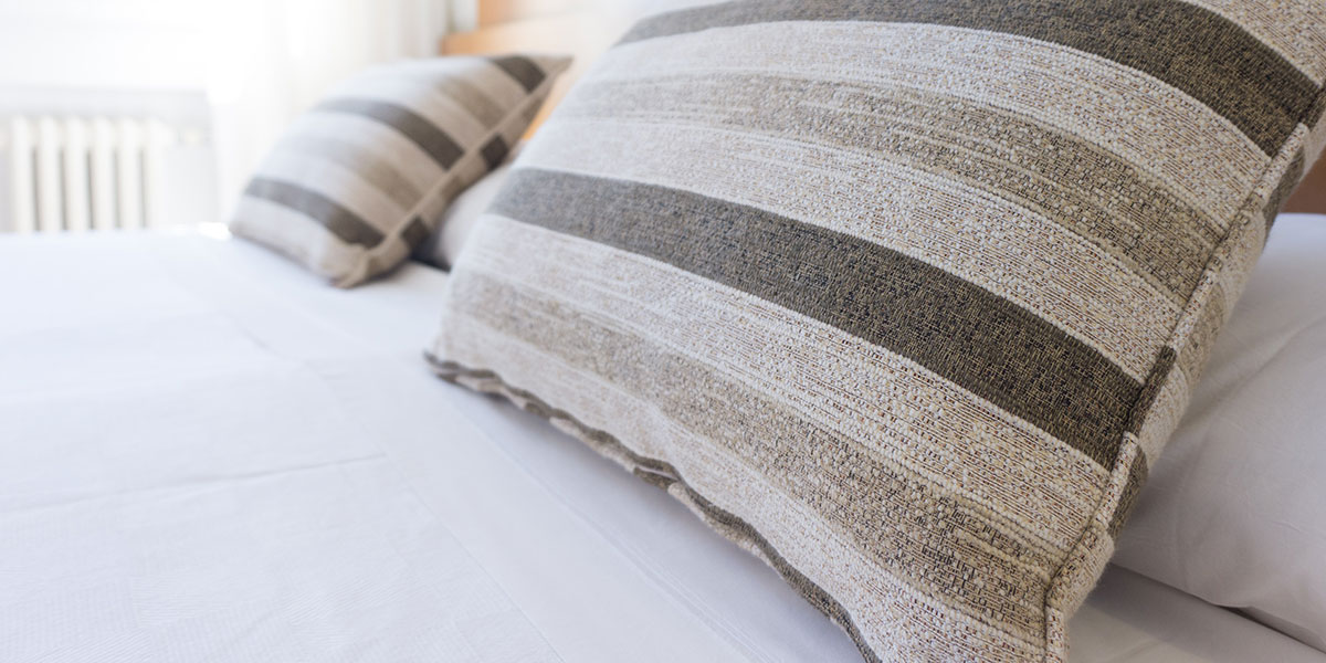 Pillows on a freshly-made hotel bed