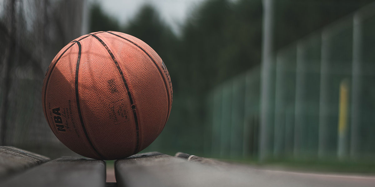 Basketball sitting on a wooden bench