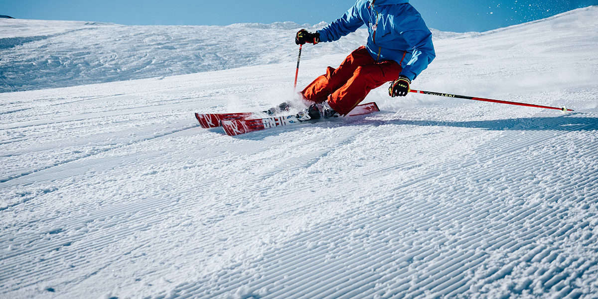 Skiing down a hill of snow
