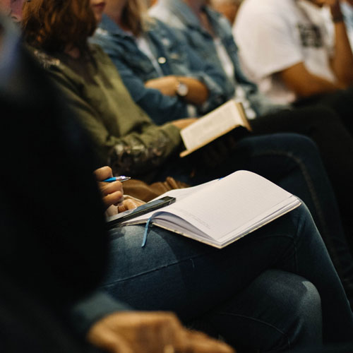 Students attending a lecture and taking notes